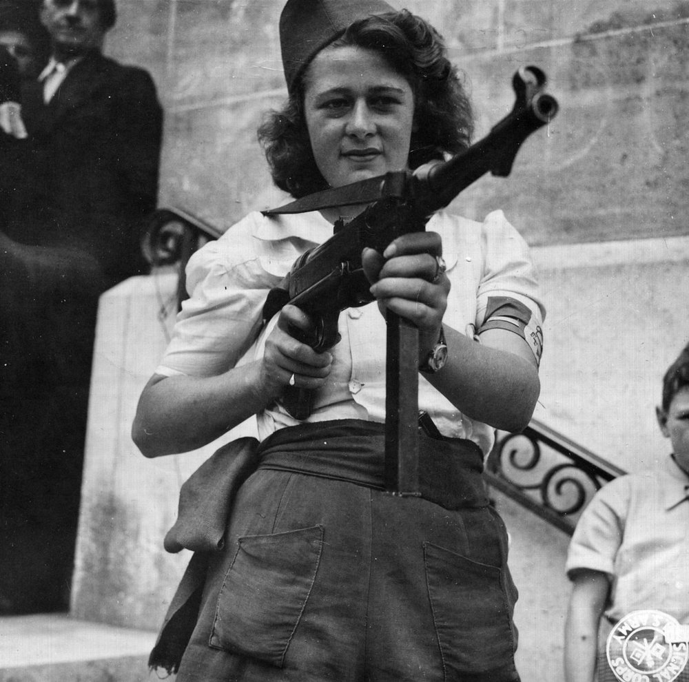 _Nicole__a_French_Partisan_Who_Captured_25_Nazis_in_the_Chartres_Area,_in_Addition_to_Liquidating_Others,_Poses_with..._-_NARA_-_5957431_-_cropped.jpg