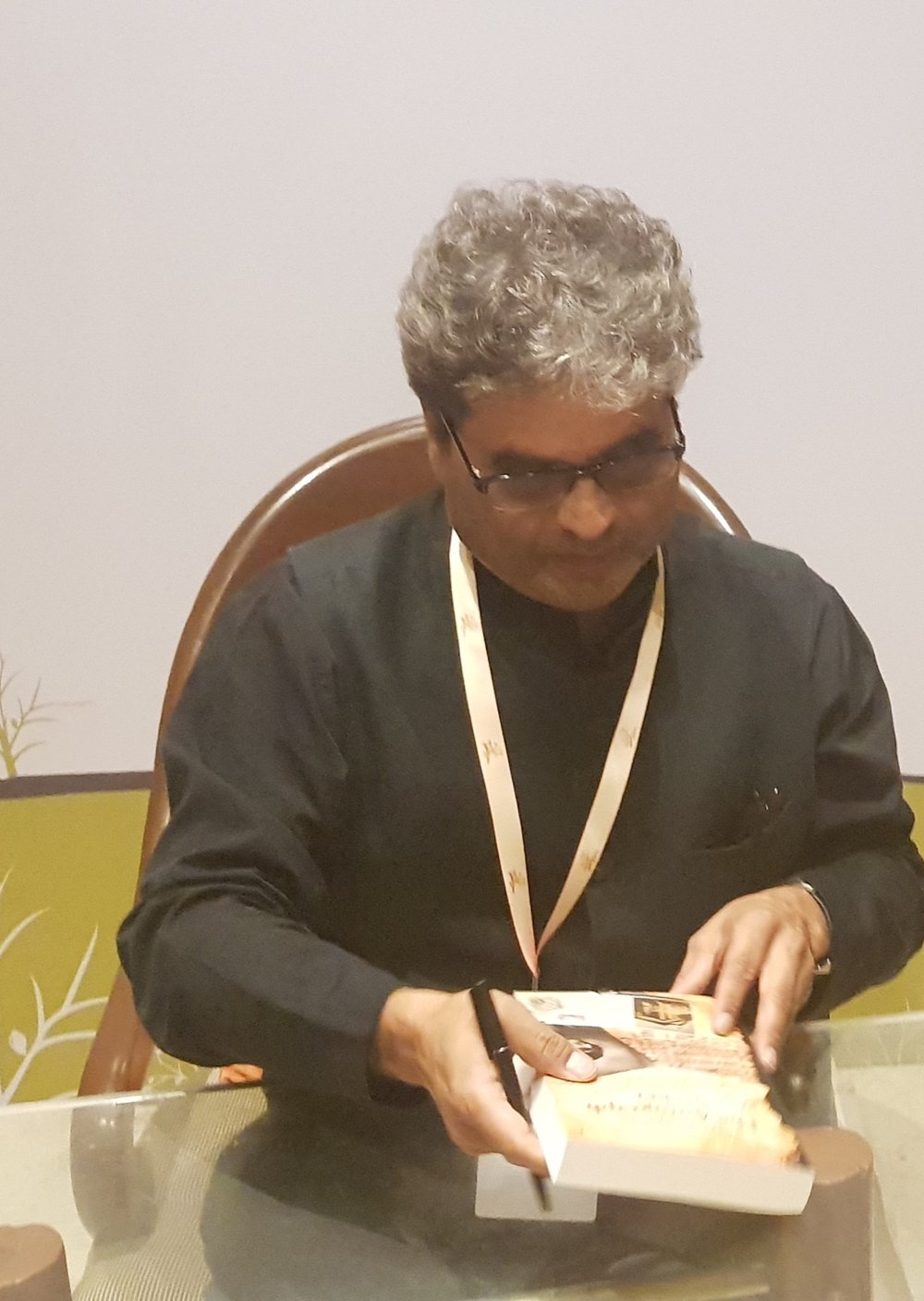 Vishal Bharadwaj, Indian Film maker and Music composer going through the novel that was long-listed for Word To Screen 2018, Mumbai Film Festival.