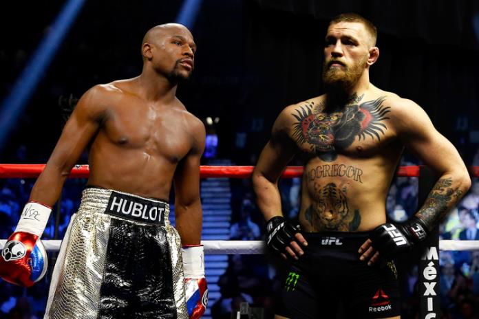 What began as a ridiculous rumour is now a certainty – Conor McGregor will face Floyd Mayweather in a traditional boxing match. There will be no combination of rules, the two men will face off, likely in Las Vegas, in a standard boxing ring and Floyd Mayweather will be given the platform to do what he does best one more time. This is a circus act that none of us should buy, but we all will.    The obvious thing to consider here is that Floyd Mayweather is the potentially the greatest defensive minded fighter to ever lace 'em up; Conor McGregor is not a great boxer, he's not even a good one. Now I don't want this article to sound one sided – In terms of an MMA style, McGregor is a great boxer. The way Conor slides in an out of range, and slips punches with ease before firing back with his slick counter punching is extremely impressive, and I haven't even mentioned 'that' left hand which put both Jose Aldo and Eddie Alvarez to sleep (and countless others before them). The issue here is that MMA boxing doesn't hold up in an actual boxing match – McGregor is used to firing in punches from a wider stance and from range due to the fact he has to be weary of potential takedowns coming back his way; in boxing that just won't work.  A traditional MMA stance would mean that McGregor would be wide open if timed correctly and there are few more well equipped fighters to read and time their opponents than Floyd 'Money' Mayweather.    I've previously heard people saying 'but if McGregor lands on Mayweather…', but there are several reasons as to why that's a very big 'if'. Firstly, McGregor has been on a knockout spree in the UFC, Diaz fights aside that's impossible to argue against. You should first see that other than Holloway, the first person that McGregor didn't KO was the best boxer he had faced – Nate Diaz.    Aside from that, a huge aspect that isn't being spoken about enough is the fact McGregor will be forced to wear standard boxing gloves rather than MMA gloves; The gloves are a huge game changer as they remove some force from the punch and also are one of Mayweather's key defensive tools as he is able to deflect a large percentage of shots away using them as his guard.    Floyd Mayweather boxes to the mantra of you can't beat him if you can't hit him; 'Money' has fought some of the most dangerous fighters in the world and in his own way, neutralised all of their offensive capabilities. From Gatti, to Judah, to De La Hoya, Hatton and Marquez, add Mosley, Cotto, Maidana, Canelo, Marquez and Pacquiao to the list and you get the point – Floyd has faced far more skilled fighters than McGregor and still had his arm raised after 12 rounds (or less in the case of Hatton and Gatti).    To add to the already unusual fighting style that Conor would be faced with, he would now be puzzled with the infamous Mayweather 'Shoulder roll'. The shoulder roll is just one element of Floyd's impeccable defence, but it's just so effective. For those that are unaware, the shoulder roll has predominantly been used by Floyd to counter Orthodox fighters (which of course Conor isn't, but I'll cover that after), he raises his shoulder to protect his face and allows him to sidestep or duck shots and remain close enough to throw counter shots. Whilst in this stance, Mayweather raises his right hand to block shots coming across his face and can brush them off with his gloves or superior reflexes. His left hand remains down by his body to prevent almost any clean shot being able to land on him effectively. However, if Conor stuck with his southpaw style then this may not be as effective, but still it's unlikely he'd cause Mayweather any issues – Manny Pacquiao is heralded as the greatest southpaw of his generation and still struggled to land a glove on Floyd.    In conclusion, this fight is a total mismatch, you only need to watch the sparring footage between Conor McGregor and Chris Van Heerden and that will show you all need to know about the Irishman's boxing credentials. The fight makes sense for both men, of course it does, it's a gigantic payday for both and relatively risk free; For Floyd it's an easy nights work, and for Conor he loses no credibility for losing to the best boxer of an era. There is worldwide interest in this for the fact that it is essentially a freak show for want of a better expression – it's unusual and something we're unlikely to see again (hopefully). The fight would almost certainly be a PPV and as I said before, although nobody should be forced to pay for this spectacle, it's projected to be the highest grossing pay per view of all time.
