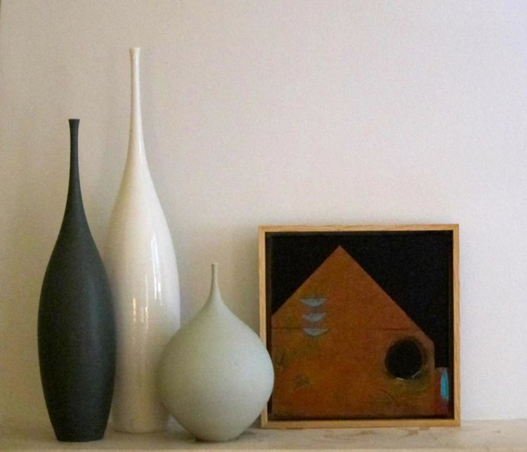 Three Boats and a Black Moon complimented by beautiful ceramic vessels by Sophie Cook