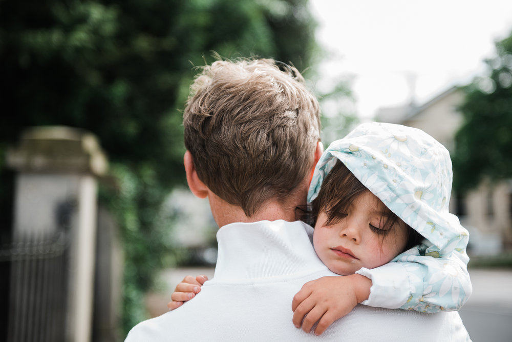 Toddler asleep in fathers arms Cheltenham Child Photography.jpg