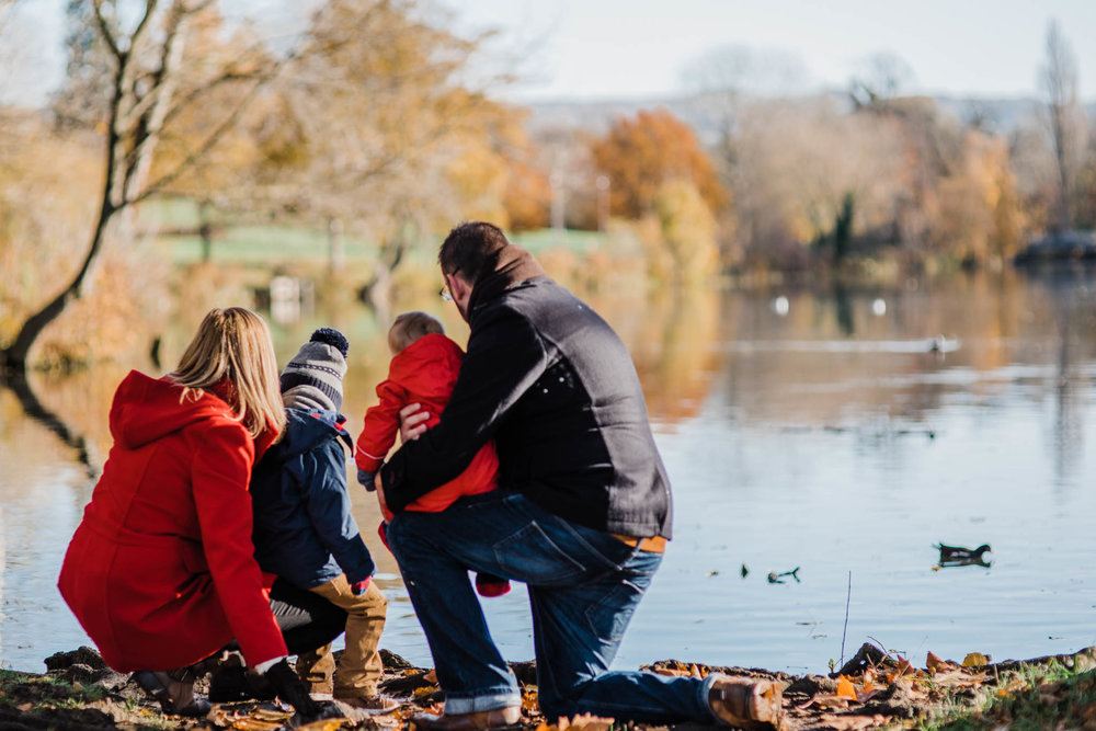 Family of four by lake pittville park family photoshoot Cheltenham.jpg
