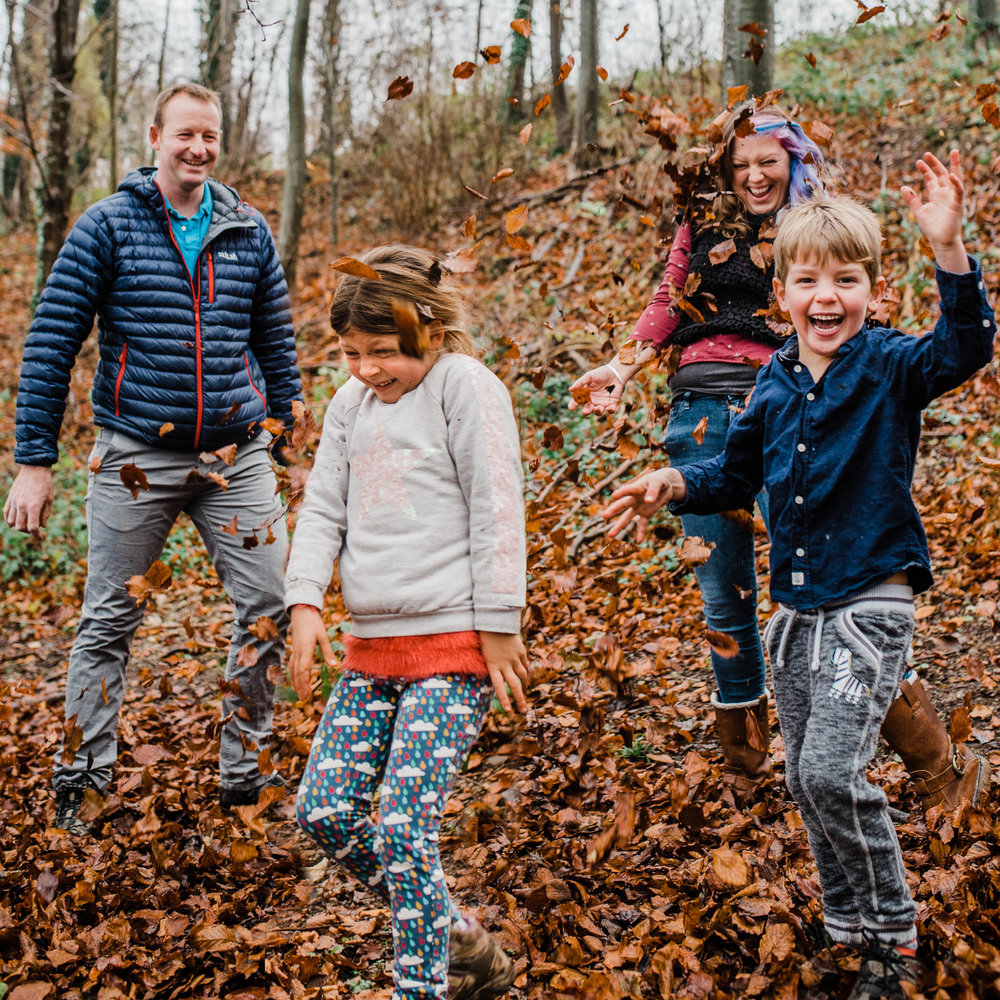 Family throwing leaves lifestyle family photography Cotswolds.jpg