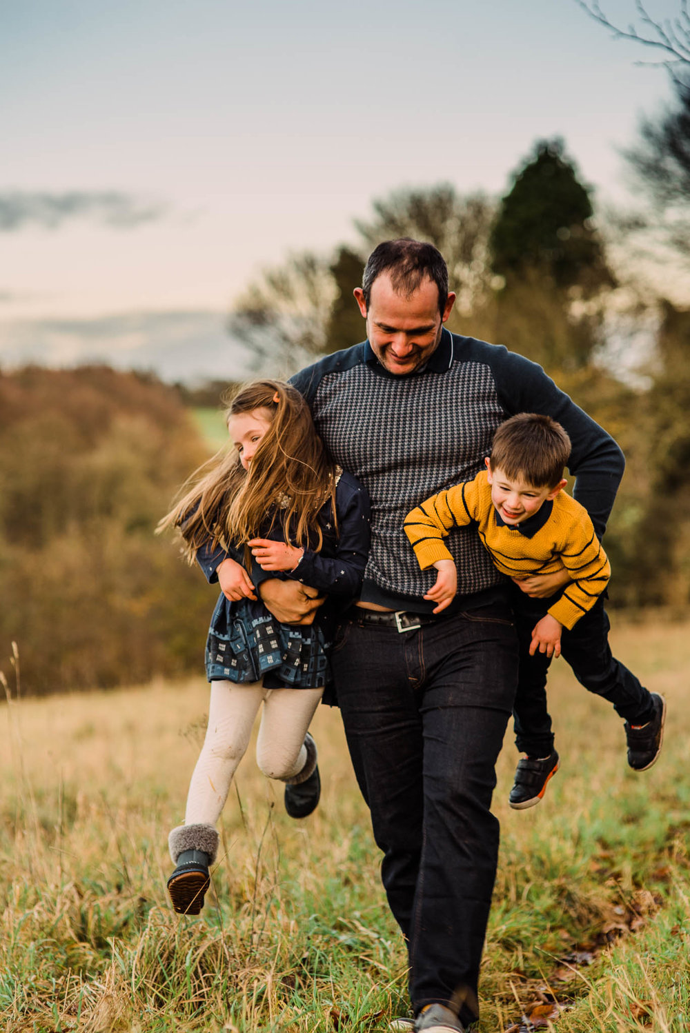 Father carrying children Cotswold Family Photoshoot.jpg