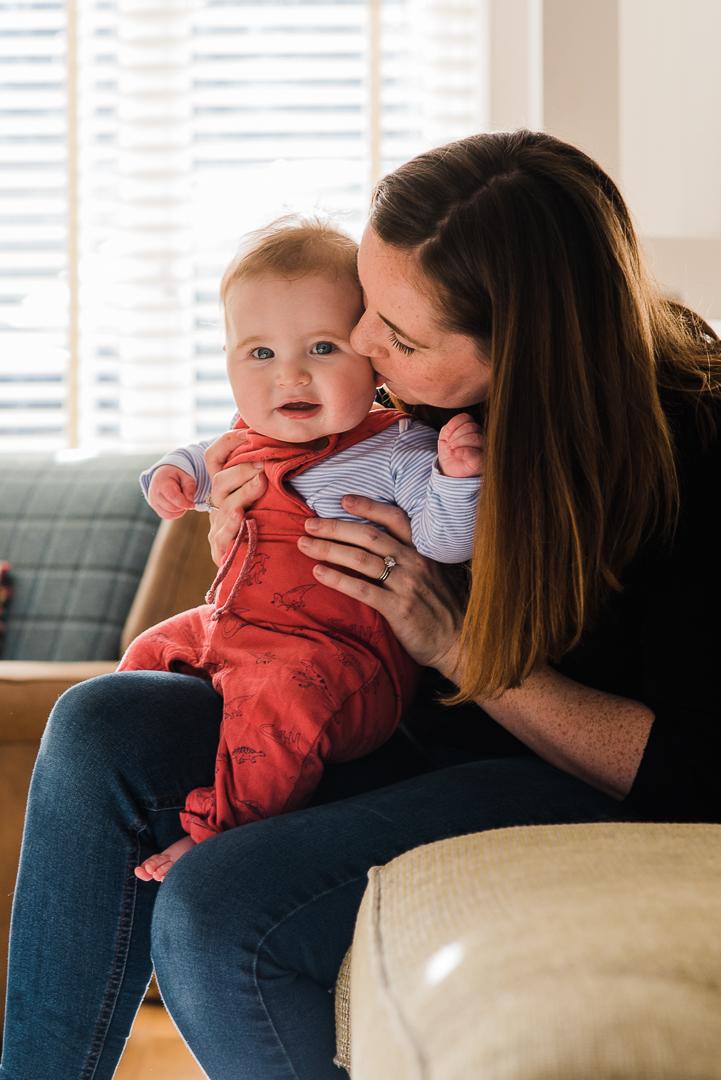 Mother cuddling baby boy in sunny home photoshoot Cheltenham.jpg