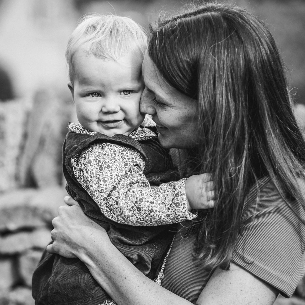 Mother cuddling toddler outdoor photography Cotswolds.jpg