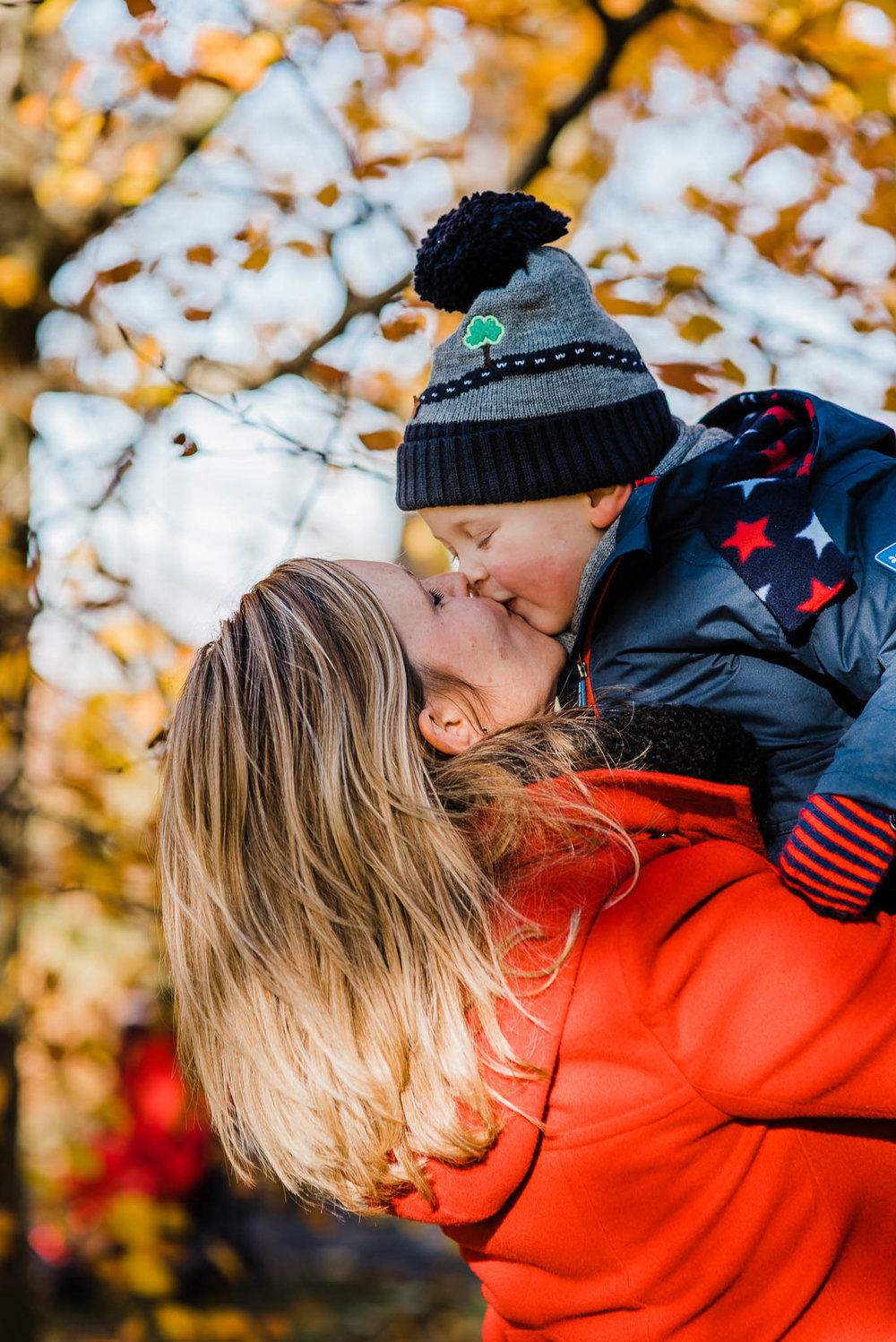 Mother kissing boy toddler in autumn  Cotswold photoshoot.jpg