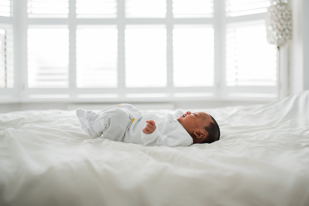 Baby lying on bed at home.jpg