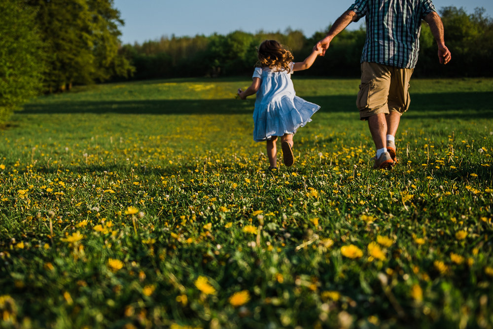 Father daughter running in field.jpg