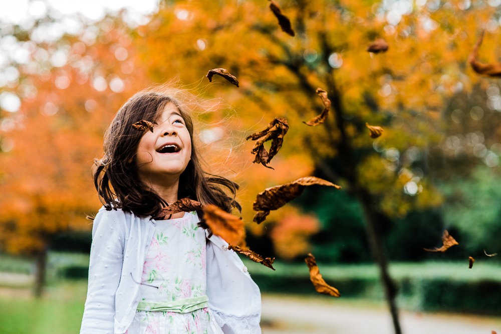 Girl throwing autumn leaves photoshoot cheltenham