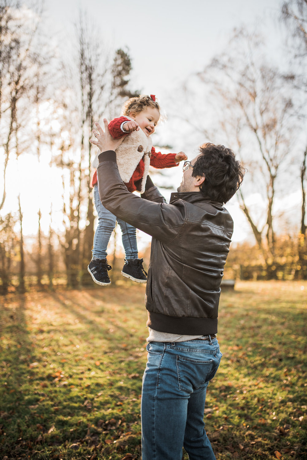 dad with child throwing in air.jpg