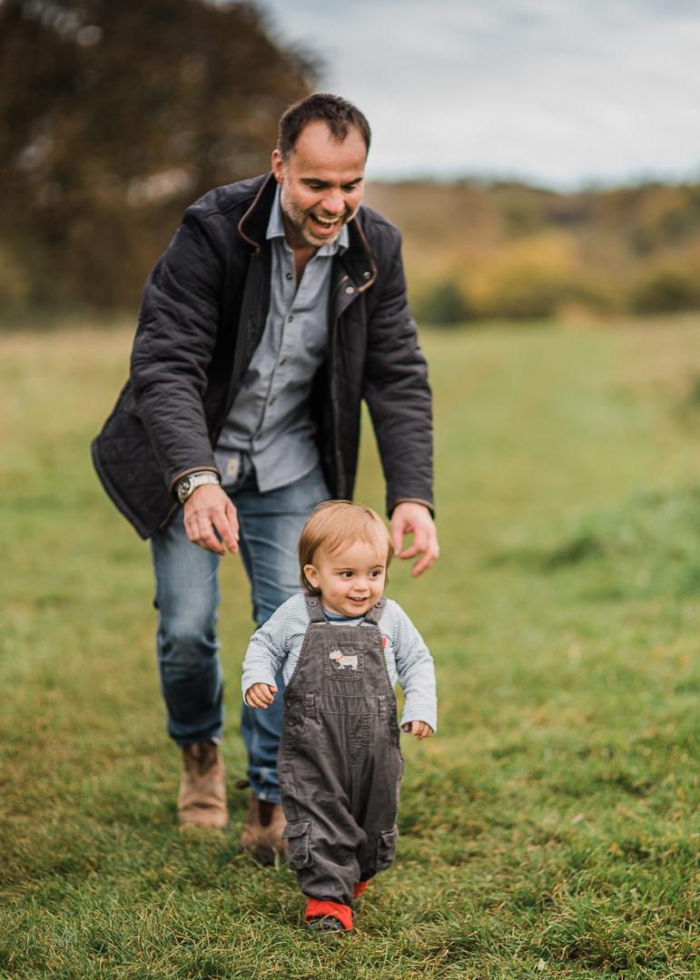 baby first steps in field with dad.jpg