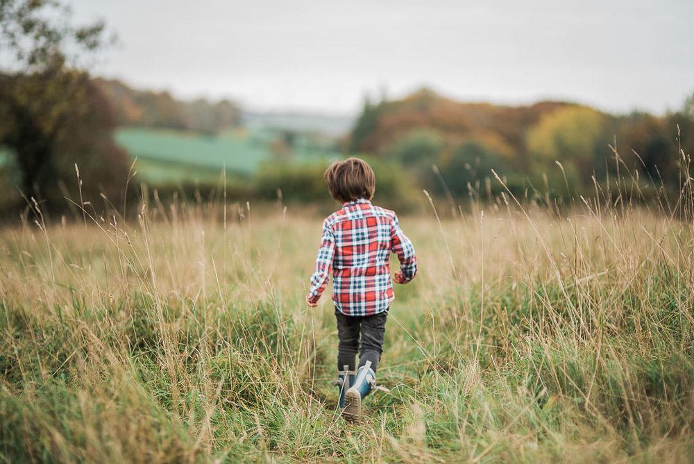 boy walking in field cotswolds.jpg