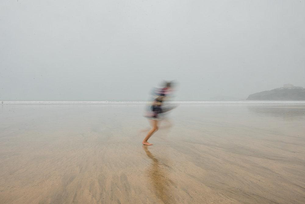 Girl running on the beach-7459.jpg