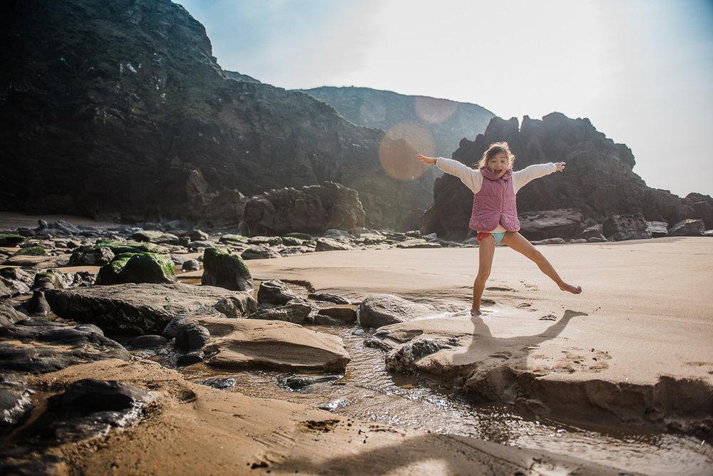 Girl jumping at the beach-7618.jpg