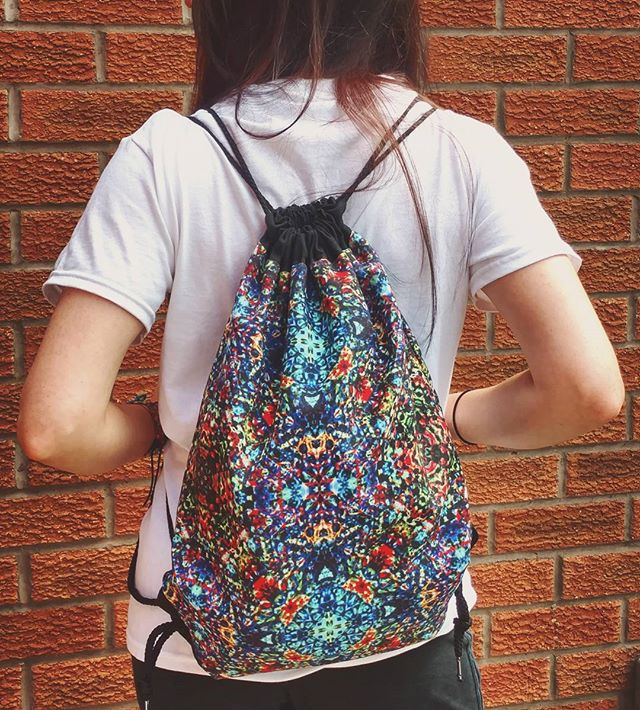 Drawstring backpack in 'Jewel'. Be totally original with this what-even-is-it, colourful, psychedelic print. The perfect bag for casual and last minute trips out! £20 with worldwide shipping - no nasty customs charges.  #bagdesign #redbubblebag #drawstringbag #sportsbag #psychedelic #trippy #patterns #colours #boho #hippie #kaleidoscopeprint #trippypattern #bohemianfashion