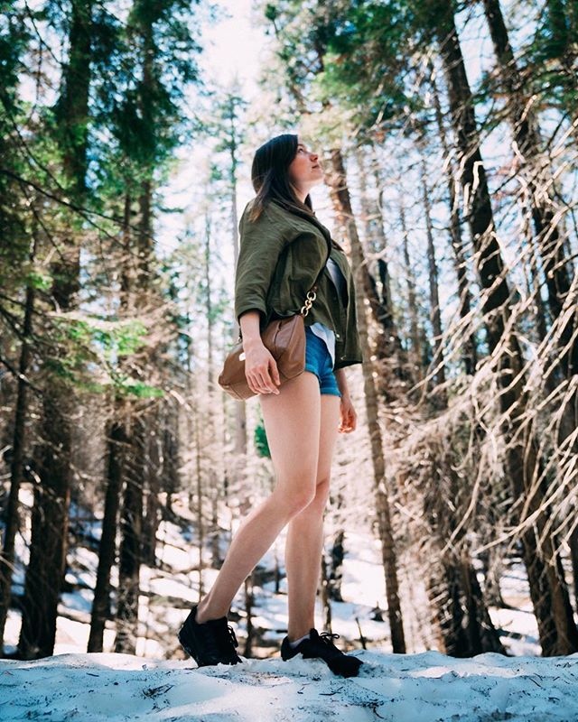This is Charlotte, Dan's wife. She wears shorts in the snow in Yosemite. ⠀ .⠀ .⠀ .⠀ .⠀ #film #Video #35mm #cinema #filmphotography #filmfeed #cinematic  #analog #pedestrianmedia #thefilmcommunity #photosofengland #englandtrip #focalmarked #photo #day #joy #love #style #beautiful #sony #artofvisuals #photography #photographer #a7 #gmaster #sonycameras #girl #model #yosemite #fashion