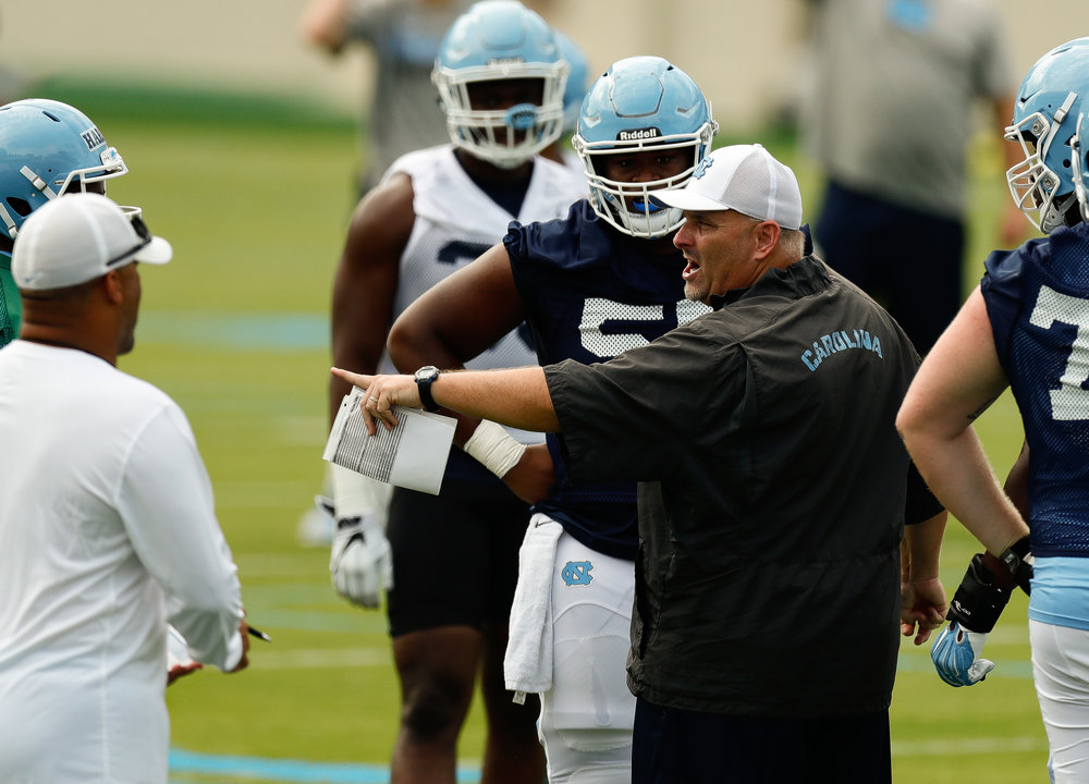 UNC's offensive coordinator and offensive line coach, Chris Kapilovic, will have to fill a hole at guard after Khaliel Rodgers' abrupt retirement. (PC Smith Hardy)
