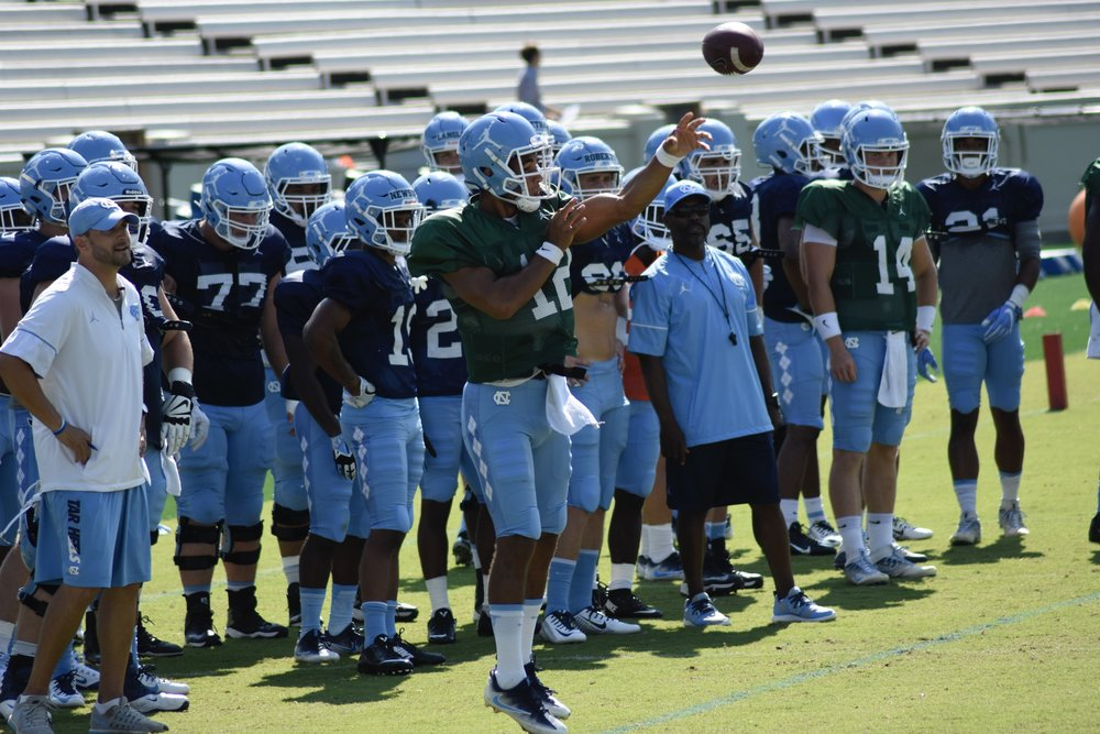 Chazz Surratt (12) hasn't played a game for UNC, but he's led the first-team offense in every scrimmage this fall.