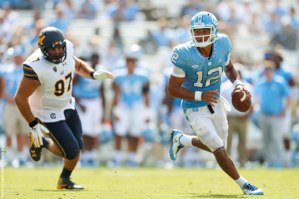 Chazz Surratt (12) spelled Brandon Harris after two series, but both quarterbacks were victims of Larry Fedora's quarterback carousel.