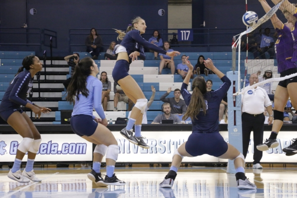 Taylor Fricano attacks against LSU. (Photo by Gabi Palacios)