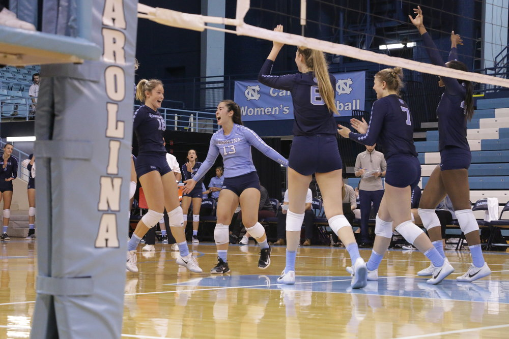 Mia Fradenburg (blue) celebrates with her teammates during a win over LSU. Photo by Gabi Palacio