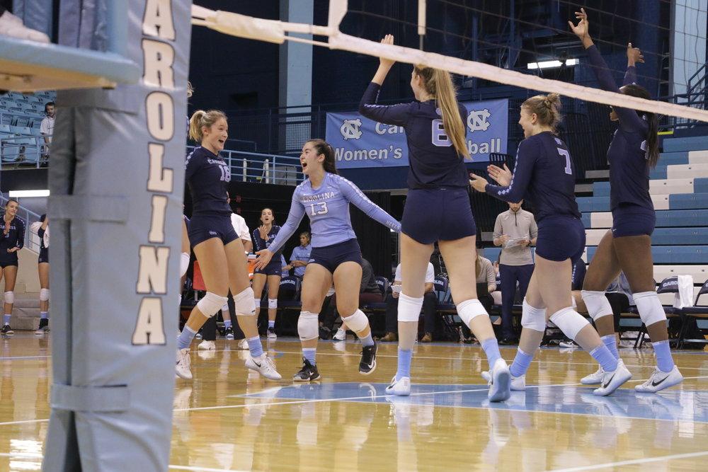 Mia Fradenburg (blue) celebrates with her teammates during a win over LSU. Photo by Gabi Palacio