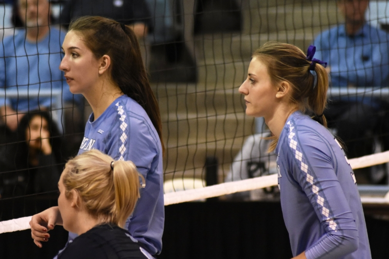 Beth Nordhorn, left, and Taylor Fricano, with libero Casey Jacobs in the foreground.