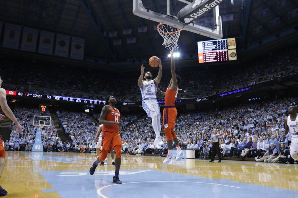 Joel Berry (2) drives and draws a foul for two of his 14 points in the second half, all in an eight-minute span.
