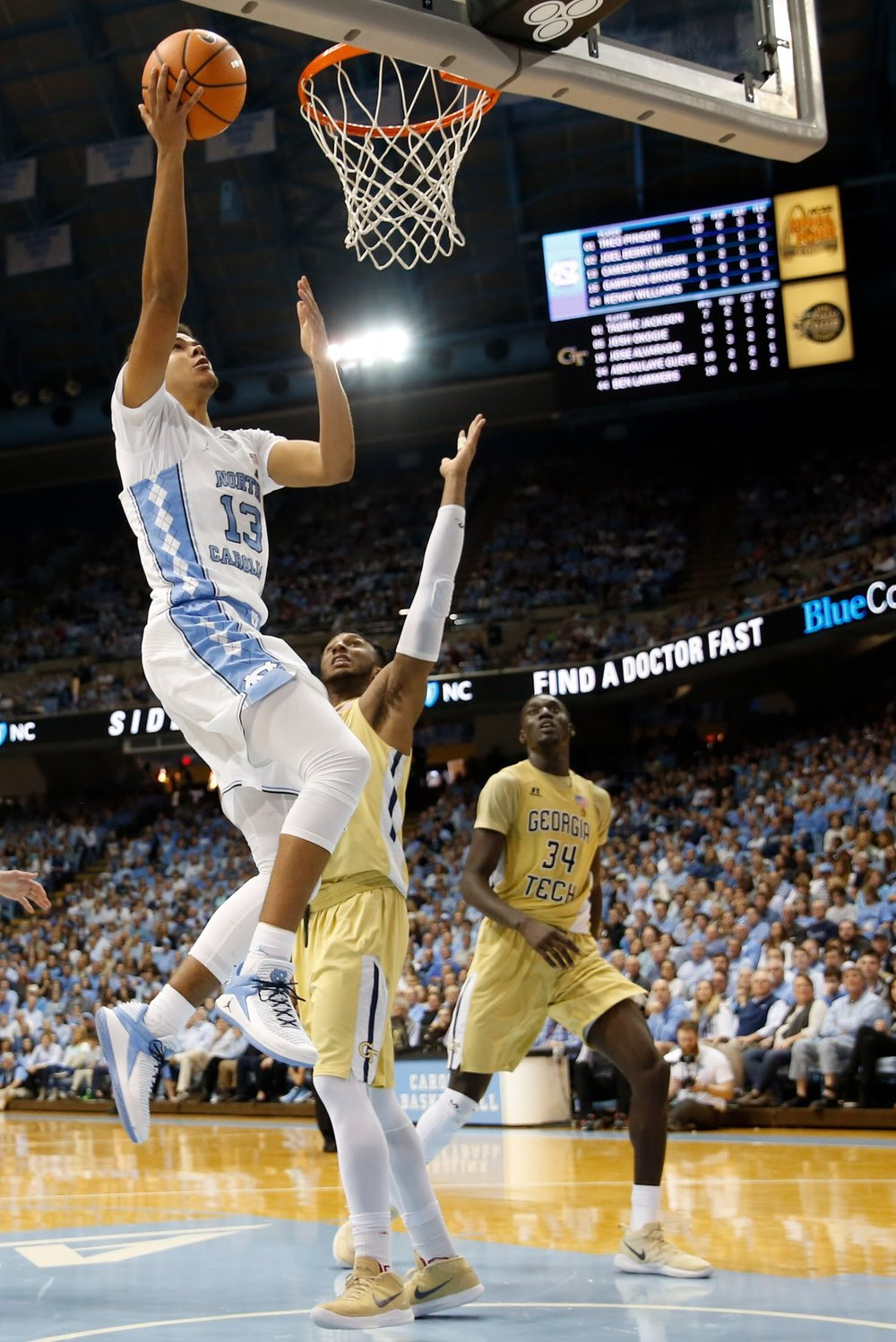 Cameron Johnson (13) scored 16 points in Saturday's win, but it was a few big shots that kept the Tar Heels in the contest. | Photo by Alex Kormann