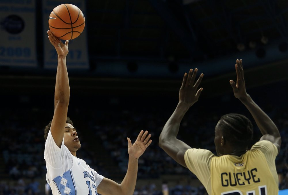 Cameron Johnson (13) uses his 6-foot-8 frame to shoot over defenders with ease. | Photo by Alex Kormann