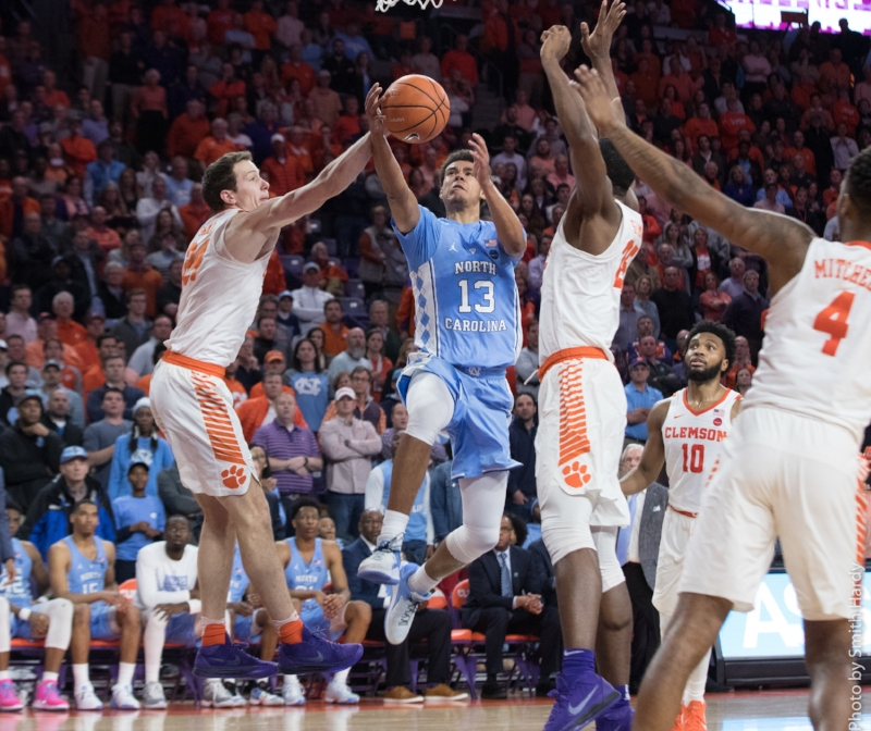 A late shot by Cam Johnson (13) was blocked by Clemson to seal Tuesday's loss, sending the Tar Heels to a .500 record in conference play with eight games left. | Photo by Smith Hardy