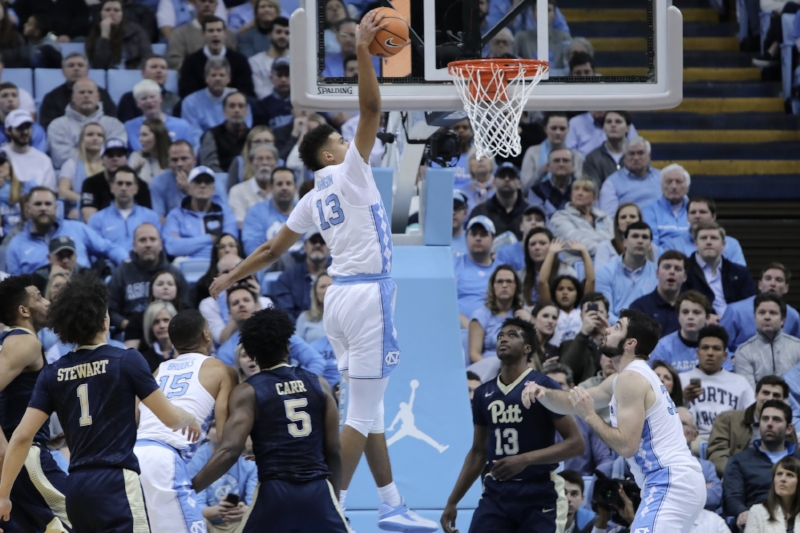 Cam Johnson (13) had a rough day from the floor, but his first made attempt was a one-handed baseline slam that energized the Smith Center crowd. | Photo by Caleb Jones