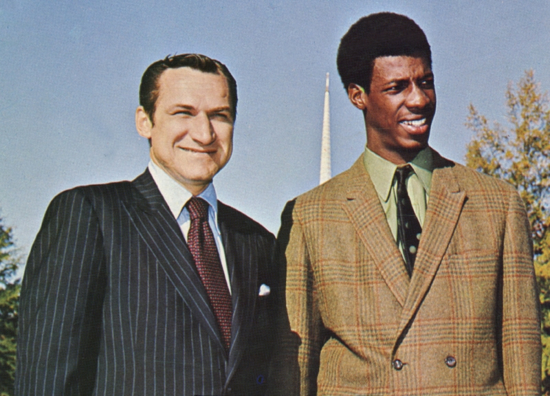 Dean Smith (left) recruited UNC's first scholarship black athlete, Charles Scott (right), during the height of the civil rights movement. It was one of many actions taken by Smith with lasting political impact. | Photo courtesy UNC Athletic Communications