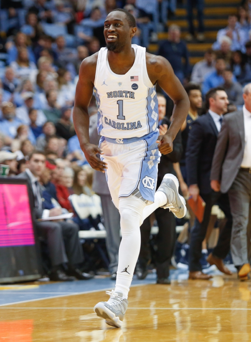 Theo Pinson (1) is a beloved figure in Tar Heel circles. But he didn't always pull for Carolina blue.