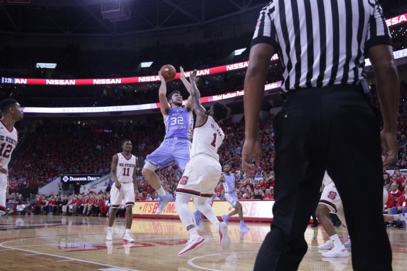 The N.C. State defense had no answers for Luke Maye (32) on Thursday, when the junior scored a career-high 33 points on 15 made shots. | Photo by Gabi Palacio