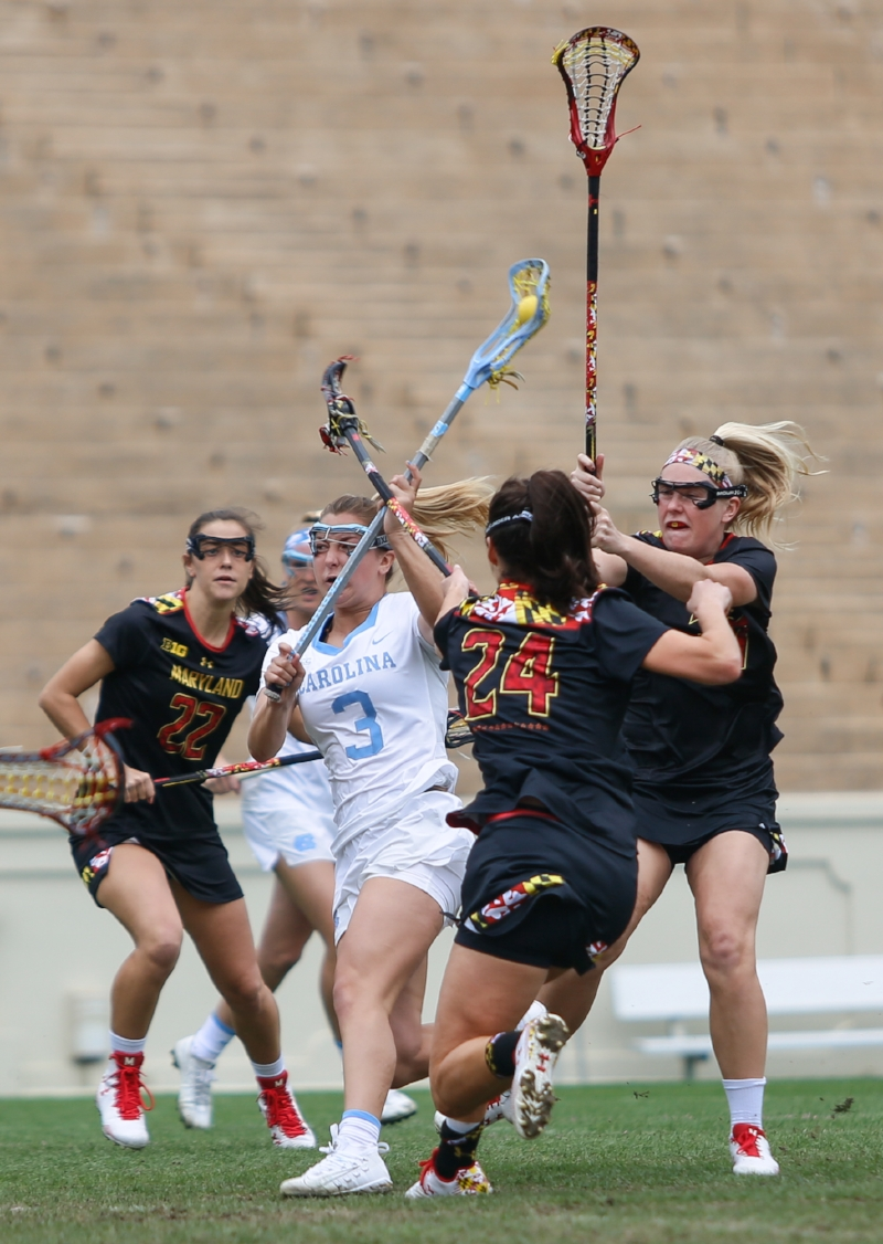 Jamie Ortega (No. 3) cuts her way through Maryland defenders to take a shot. The star freshman finished the game with four goals and two assists. | Photo by Alex Kormann