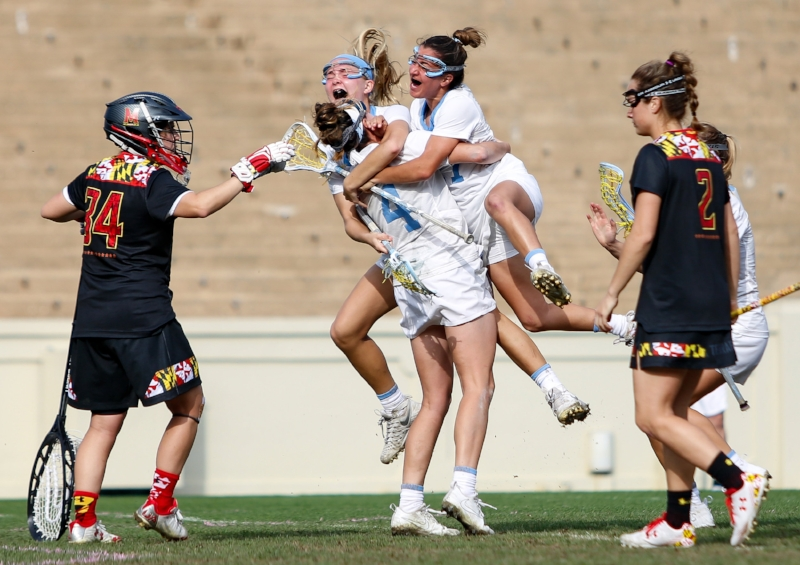 UNC players swam Marie McCool (No. 4) after she scores the winning goal in overtime to clinch the game for the Tar Heels. The senior scored four goals on the afternoon to give Maryland its first regualr season loss since 2014. | Photo by Alex Kormann