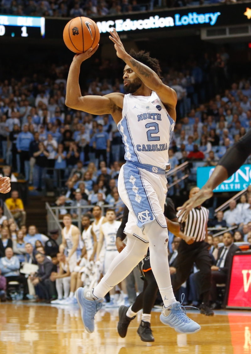 Joel Berry (2) had 31 points in his Smith Center finale, including three with 4.1 seconds left to tie the game. But Miami's Ja'Quan Newton had other ideas, spoiling the senior night celebrations. | Photo by Alex Kormann