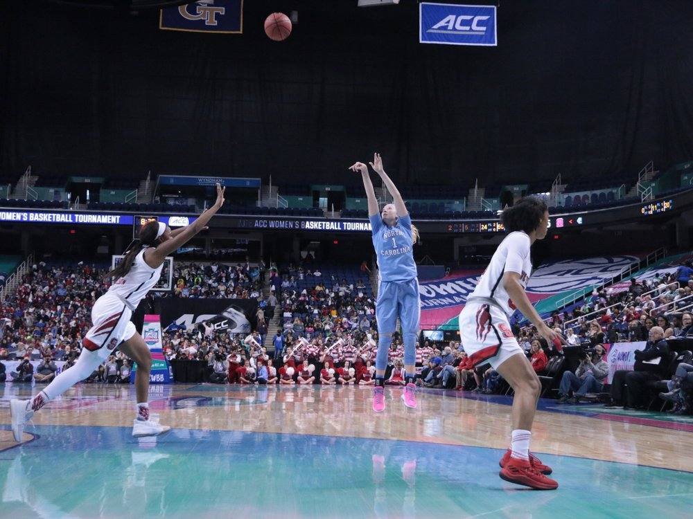 Taylor Koenen (1) airballed multiple shots in Thursday's loss, like this one with 8:37 left in the fourth quarter against N.C. State. It was emblematic of UNC's many missed opportunities, in the ACC Tournament and beyond. | Photo by Gabi Palacio