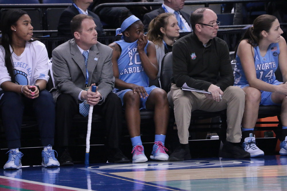 Jamie Cherry (10) watched from the sidelines as the final seconds of her UNC career ticked away in Thursday's loss to N.C. State in the ACC Tournament. Cherry is the lone senior on this team, a holdover from before the 2015 transfers that changed the program. | Photo by Gabi Palacio