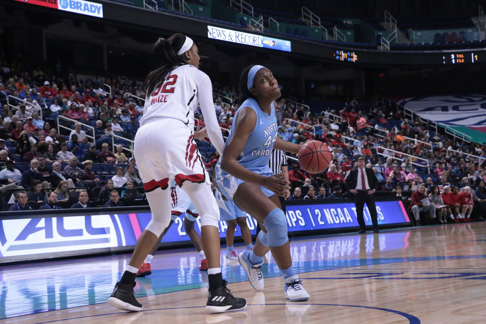 Janelle Bailey (44) imposed her will for much of the year. But her emotions got the best of her in Thursday's loss to N.C. State, as a technical foul after an incident with Akela Maize (32) helped the Wolfpack dominate the frontcourt in her absence. | Photo by Gabi Palacio