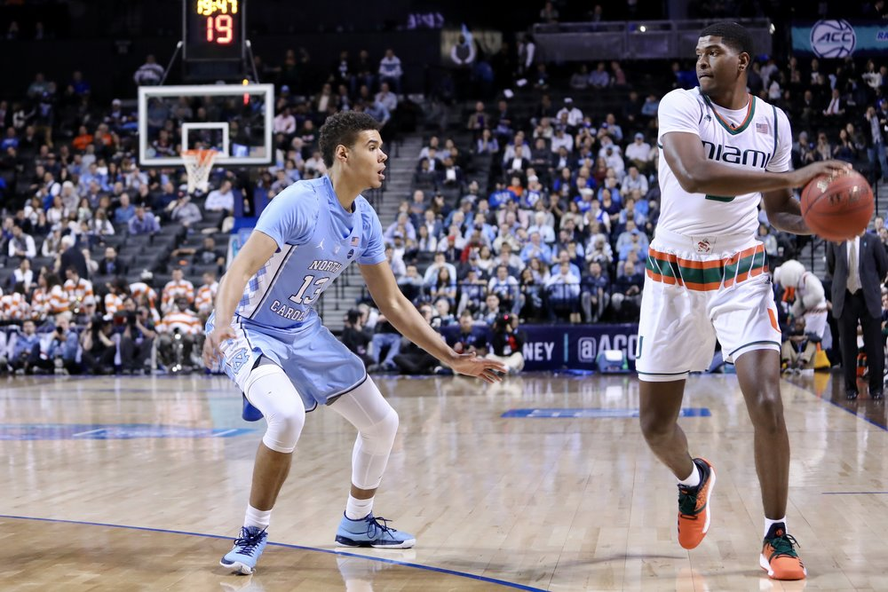 Cam Johnson (13) said UNC wanted to come out in Thursday's ACC Tournament semifinal against Miami with an edge. But early on, it looked as if the Tar Heels were about to fall off one. | Photo by Caleb Jones