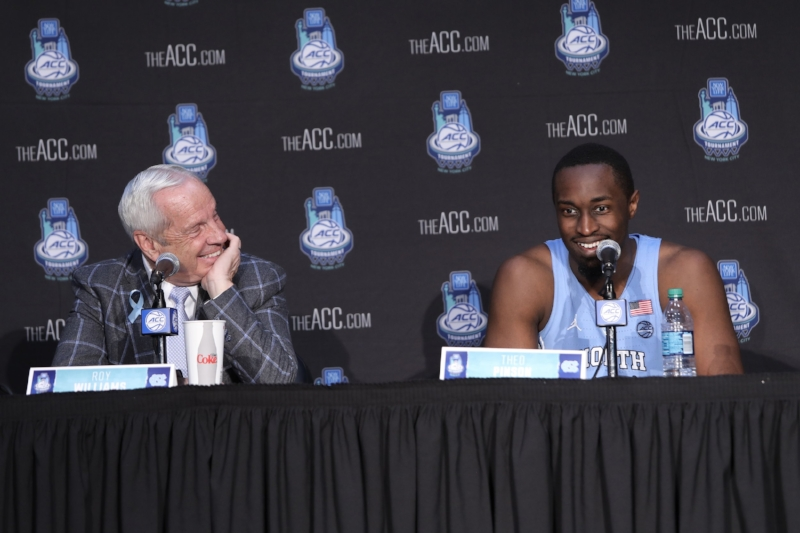 Roy Williams (left) hadn't forgotten about UNC's gut-wrenching loss to Miami in senior night. Neither had Theo Pinson (right), who scored 25 points to lead the Tar Heels to an ACC Tournament semifinal rematch with Duke. | Photo by Caleb Jones