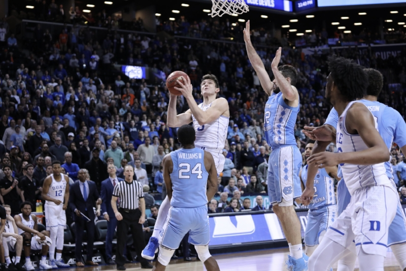 Kenny Williams (24) took a crucial charge against Grayson Allen to seal UNC's ACC Tournament semifinal win over Duke. It was a defensive play emblematic of the Tar Heels' late-season progression. | Photo by Caleb Jones