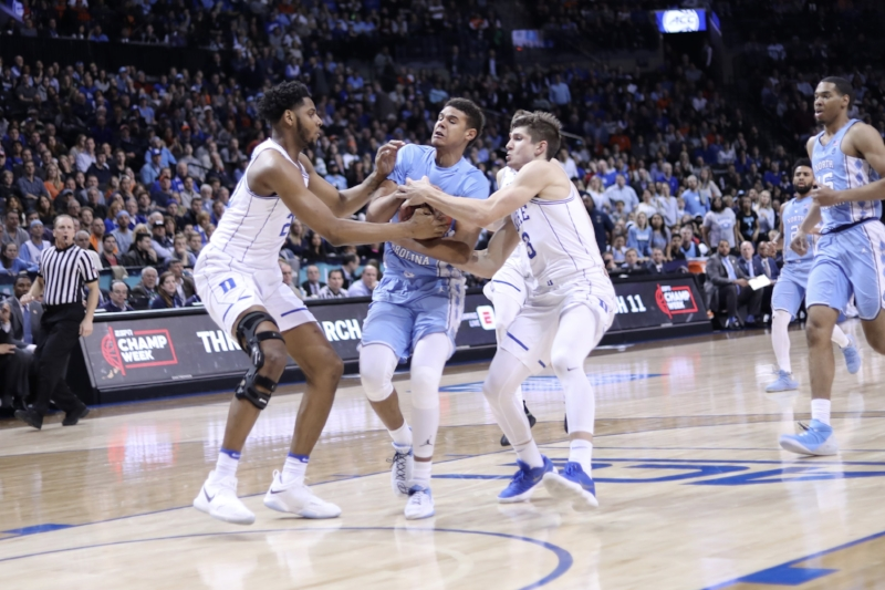 The Tar Heels' offense went cold in the final minutes against Duke, just as it did for much of the game against Virginia in January. Cam Johnson (13) and co. know they'll have to be much more efficient to break through the Cavaliers' pack-line defense on Saturday in the ACC Tournament final. | Photo by Caleb Jones
