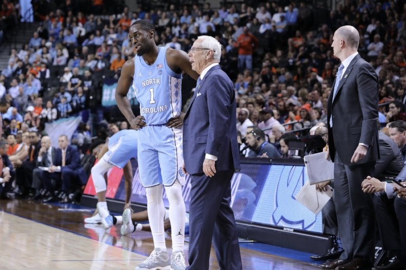 Roy Williams (right) has coached plenty of teams that won their conference tournament championships. None of them won the NCAA title. | Photo by Caleb Jones