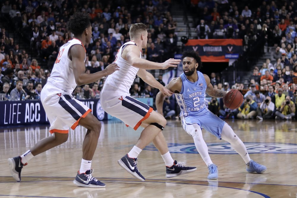 Joel Berry (2) knows the feeling of winning ACC Tournament MVP award. He also knows the feeling of winning the Final Four Most Outstanding Player award. After Saturday's loss to Virginia, the UNC senior couldn't care less about the former. | Photo by Caleb Jones.