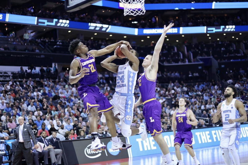 Kenny Williams (24) waited 713 days between NCAA Tournament appearances — from the 2016 Final Four until Friday's win over Lipscomb. He make the most of it, leading UNC with 18 points. | Photo by Caleb Jones