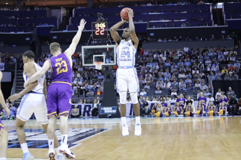 Kenny Williams (24) hit four consecutive three-point shots on Friday, capped off by this shot above to put UNC ahead by 16 points over Lipscomb. It was the type of game he had dreamed of growing up. | Photo by Caleb Jones